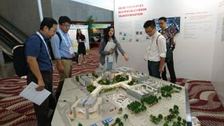 高市府參加永續建築國際會議發表太陽光電計畫。(圖/高雄市政府工務局提供)