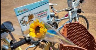 高管處為歡慶父親節,河濱公園內15個自行車租借站推出「騎車送向日葵」活動。(圖/高管處提供)